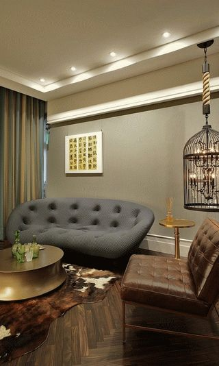 Eclectic-living-room-with-a-bird-cage-lighting-option-600x999